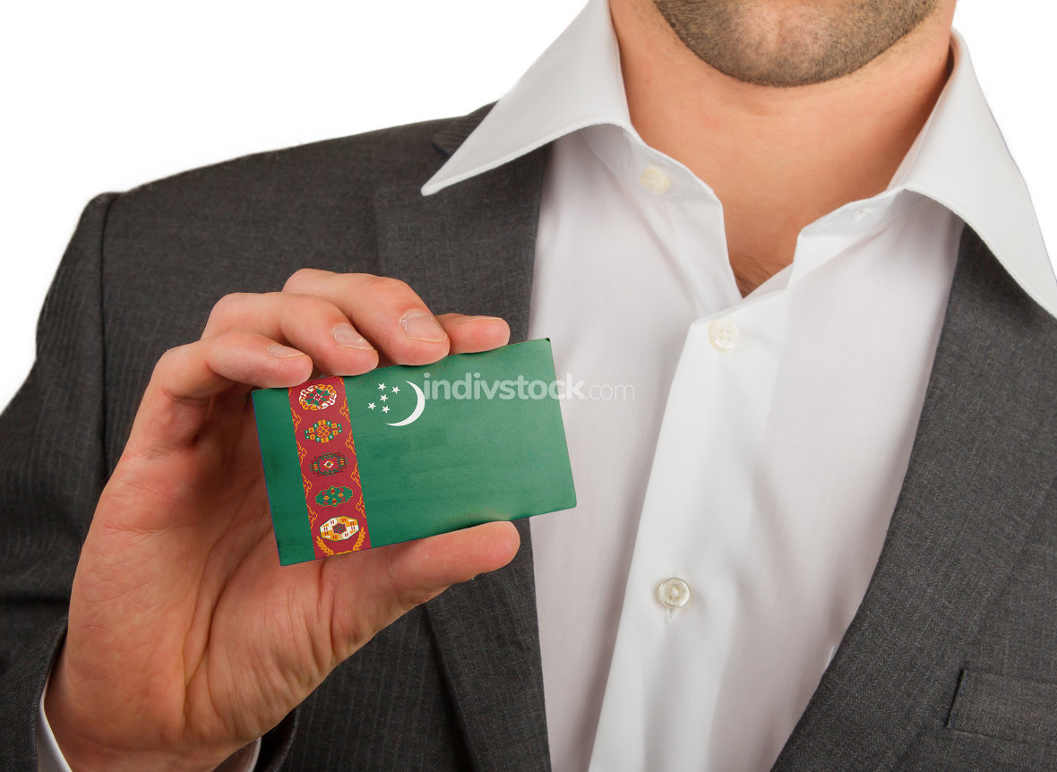 Businessman is holding a business card, Turkmenistan