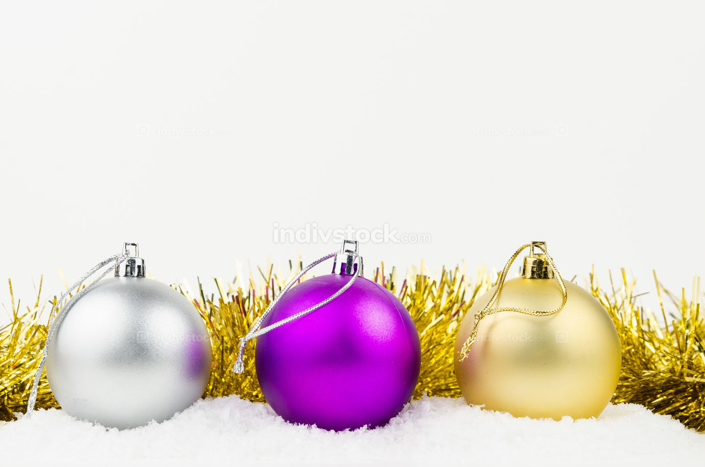 Christmas balls with golden garland isolated on white background