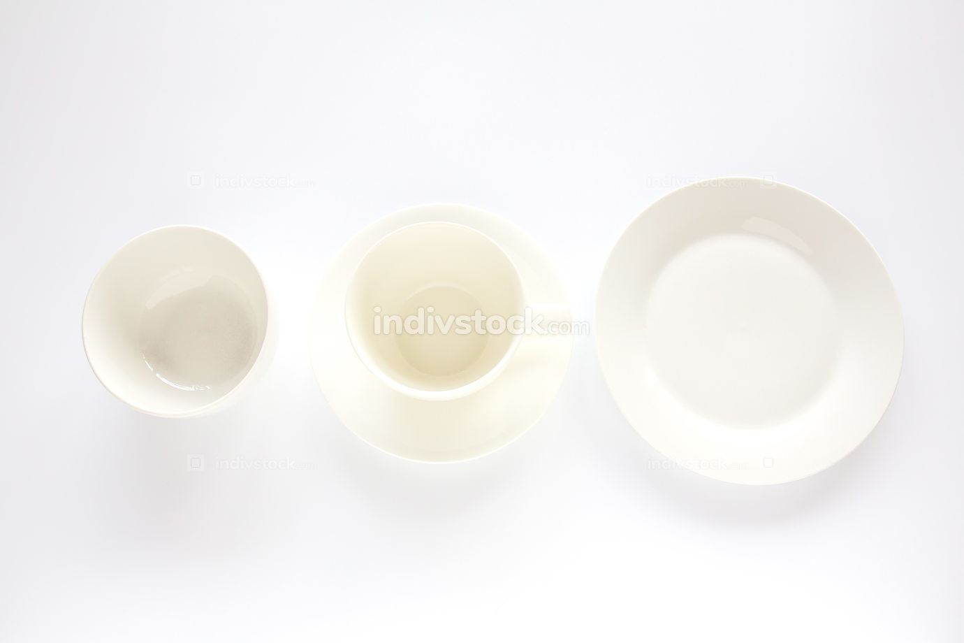 Empty white plate,white cup and white bowl on white background