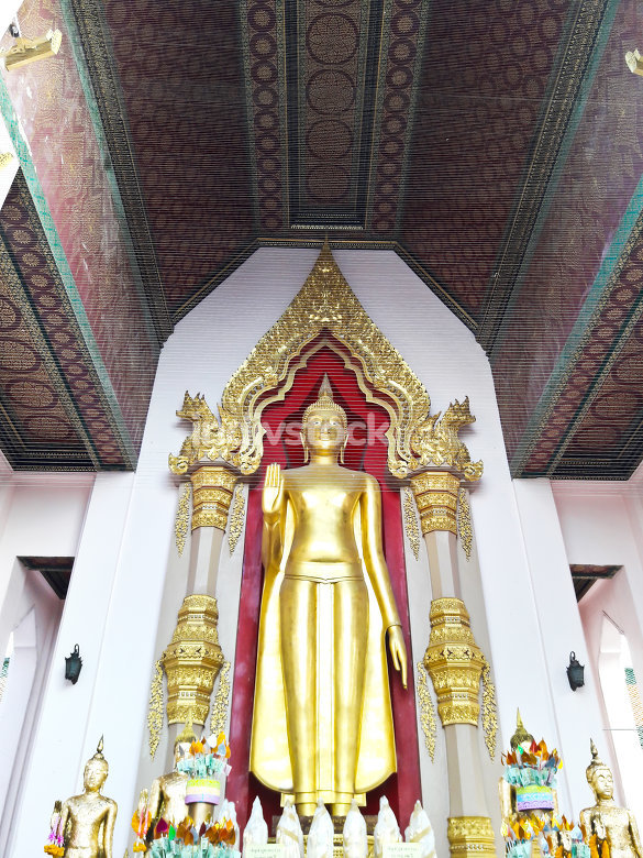 Golden buddha stands at Nakhon Pathom, thailand