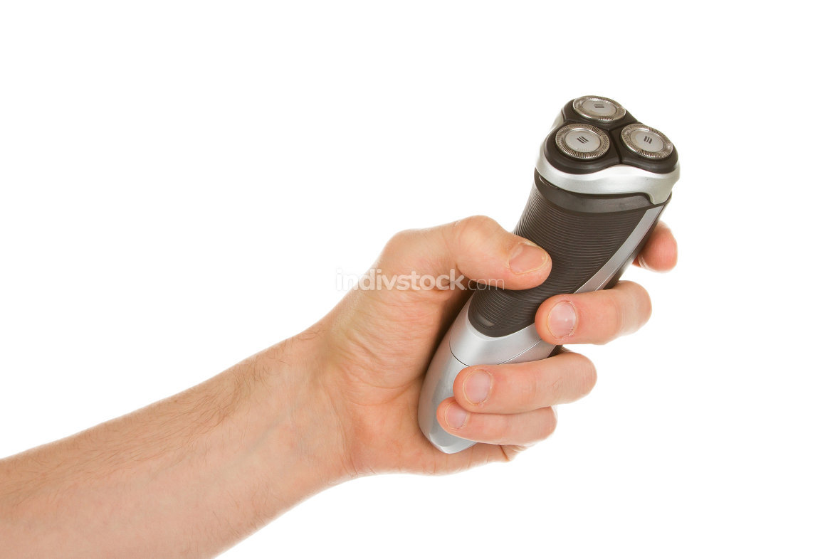 Hand holding an electric shaver