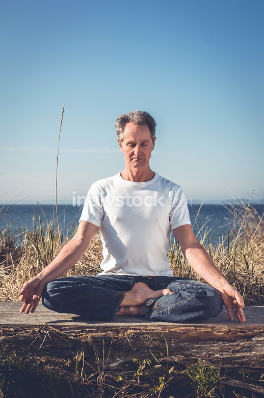Man sitting in yoga pose.