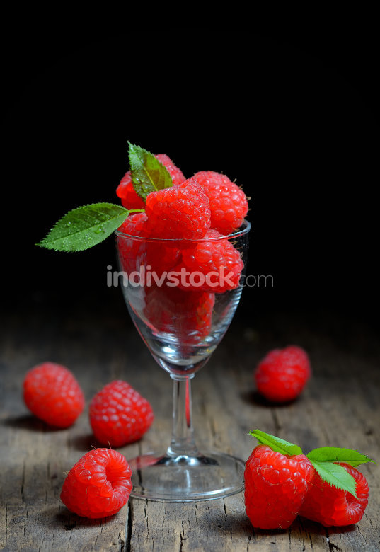 Raspberries in small glass