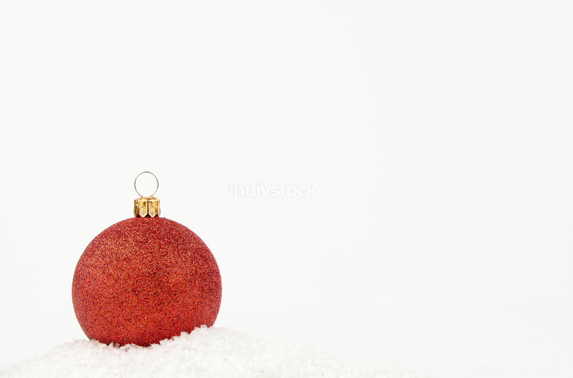 Red Christmas ball with snow isolated on white background