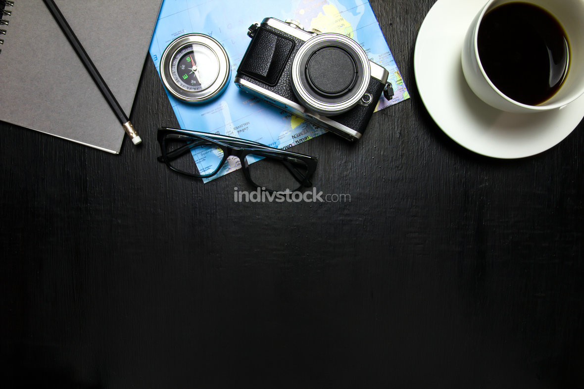 Top view of office desk workspace with coffee cup, camera ,world