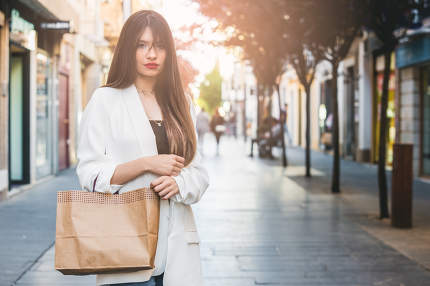 Beautiful woman buying in comercial street