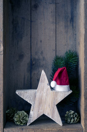 Christmas decoration Santa Clause hat on a star in a wooden box