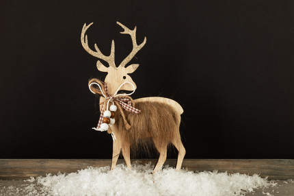 Christmas decoration wooden reindeer in snow