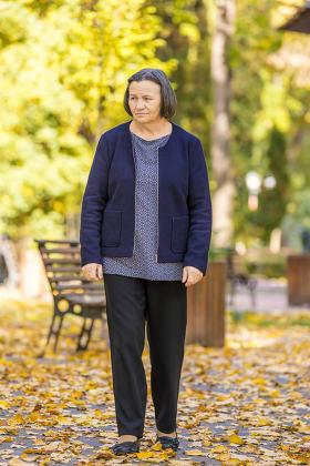 Depressed senior woman outdoors