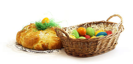 easter basket with easter eggs and yeast pastries bread plait