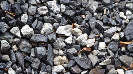 Grey color small stone floor texture