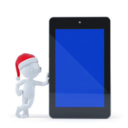 Happy Santa Claus with blank screen tablet computer
