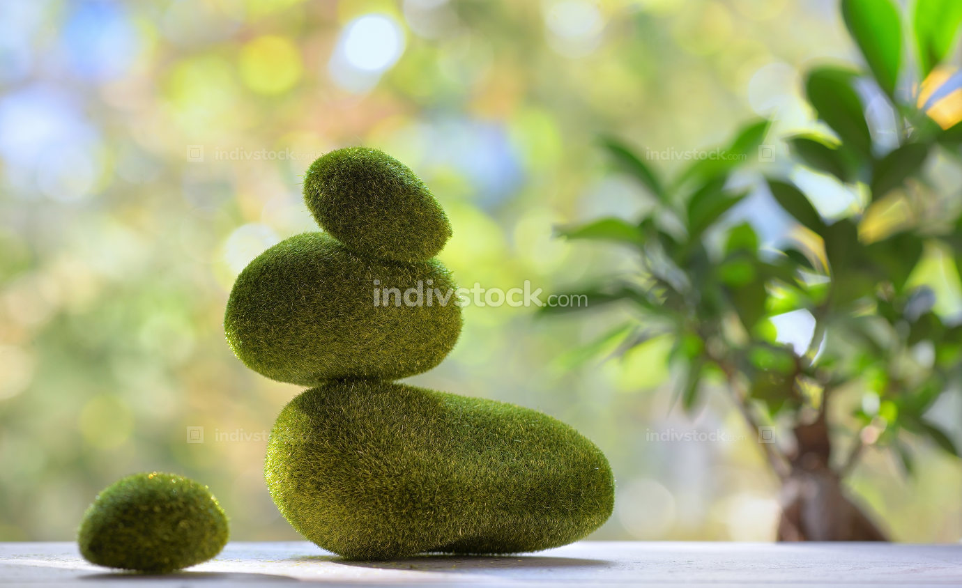 Balanced stones with moss