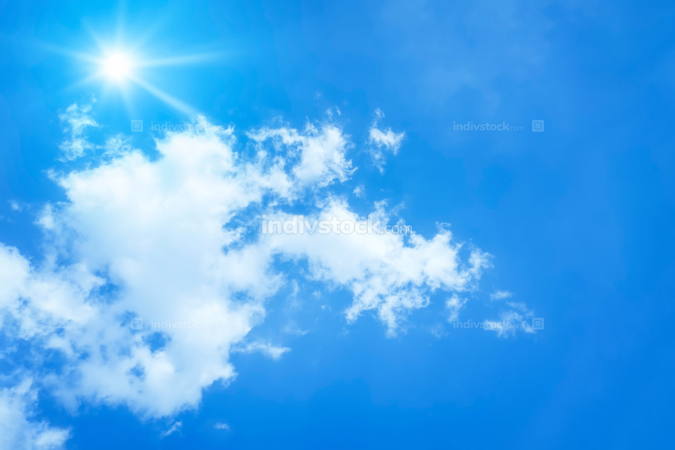 bright blue sky with sun and clouds background