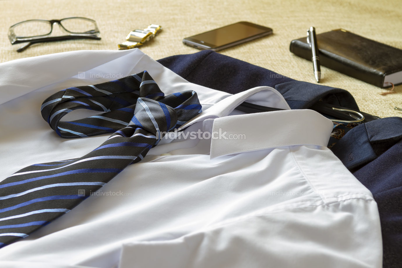 Business man clothes and accessories on bed