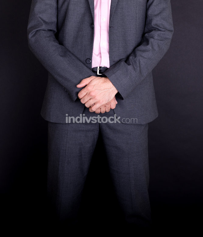 Businessman standing with hands folded