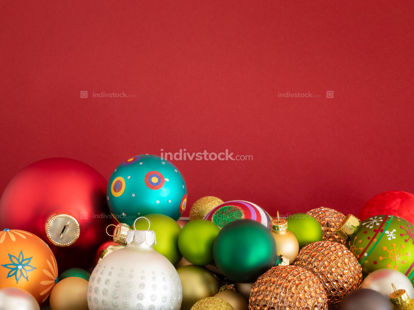 Christmas decoration glass balls on red background