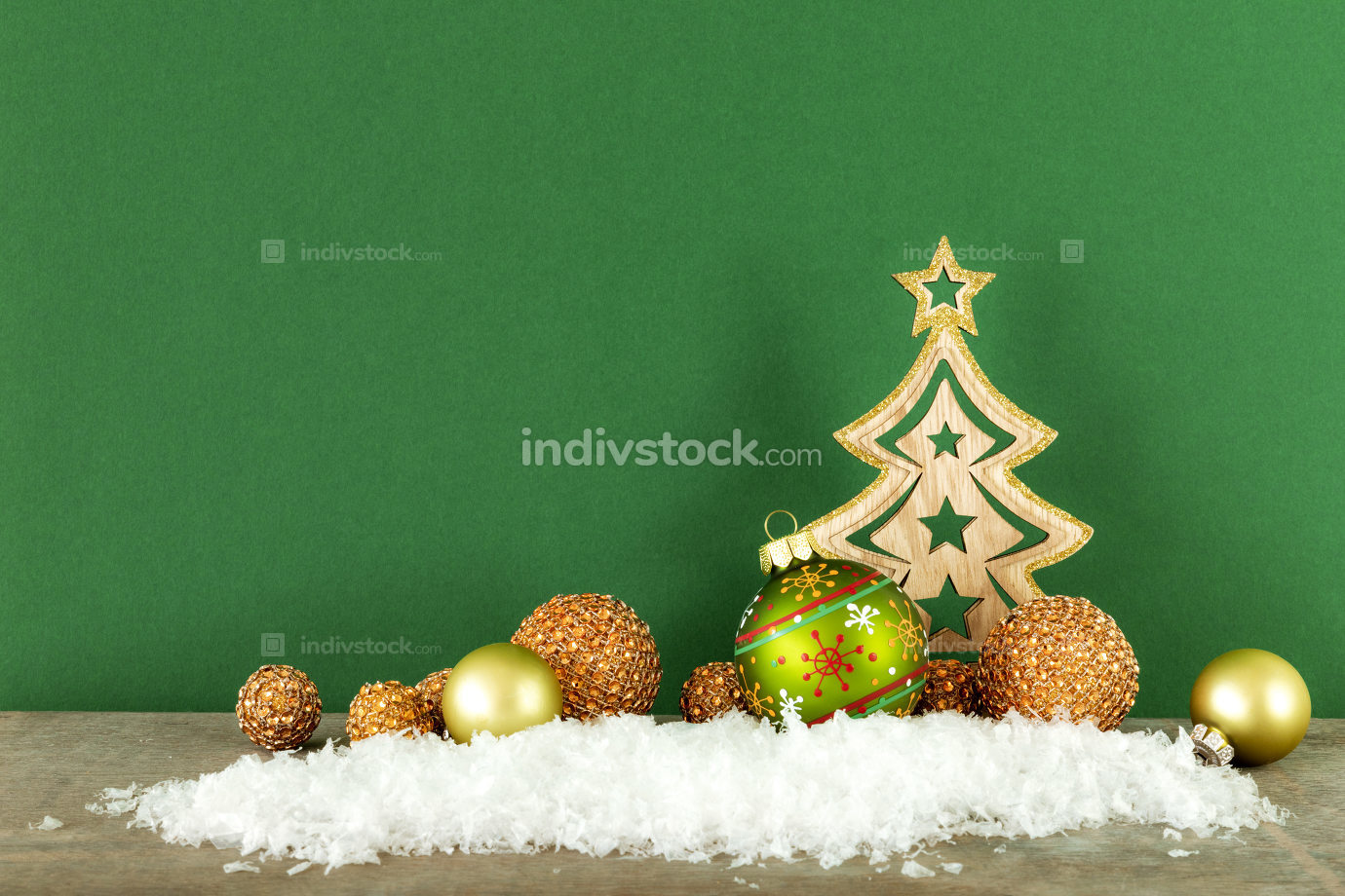 Christmas decoration green background with wooden tree glass bal