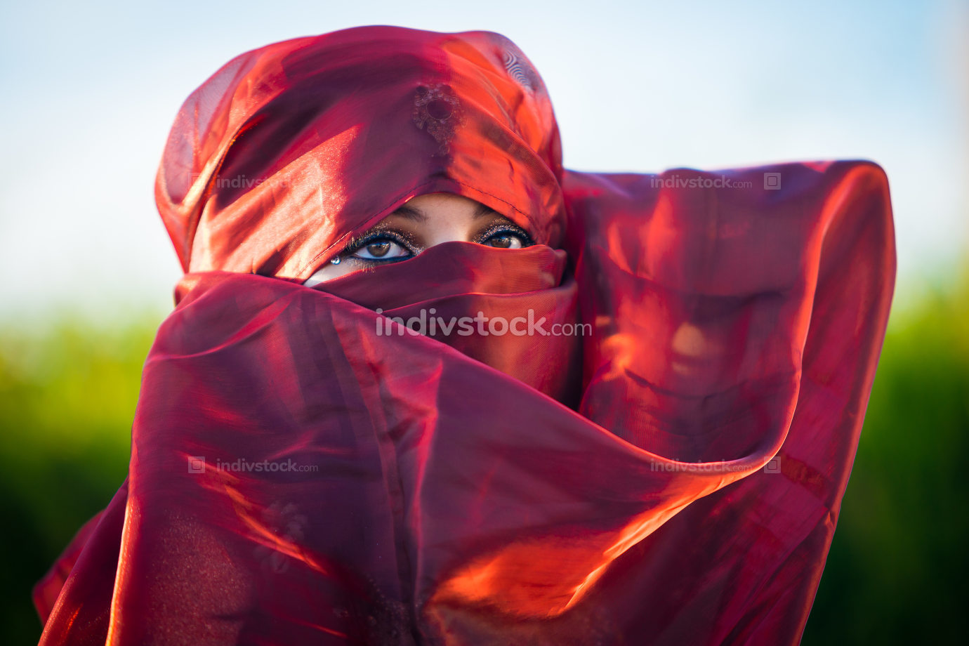 Close up view of brown woman eyes framed by headscarf