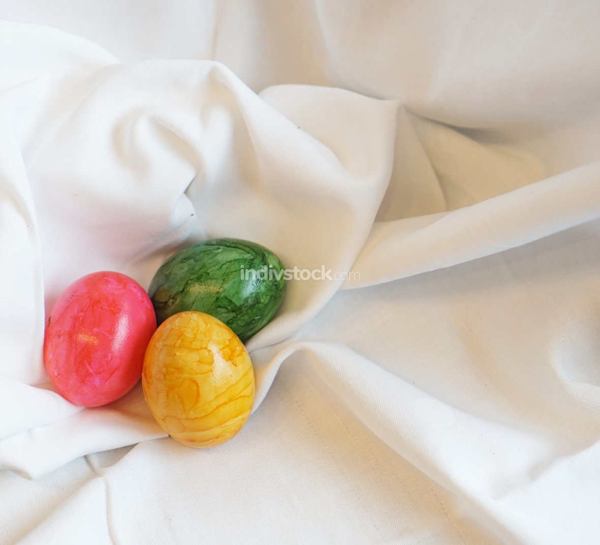 colorful Easter eggs at soft satin
