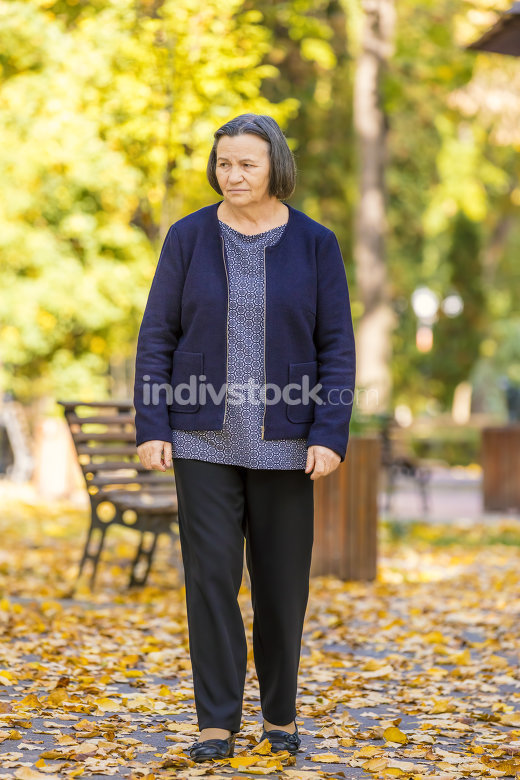 Depressed senior woman outdoors