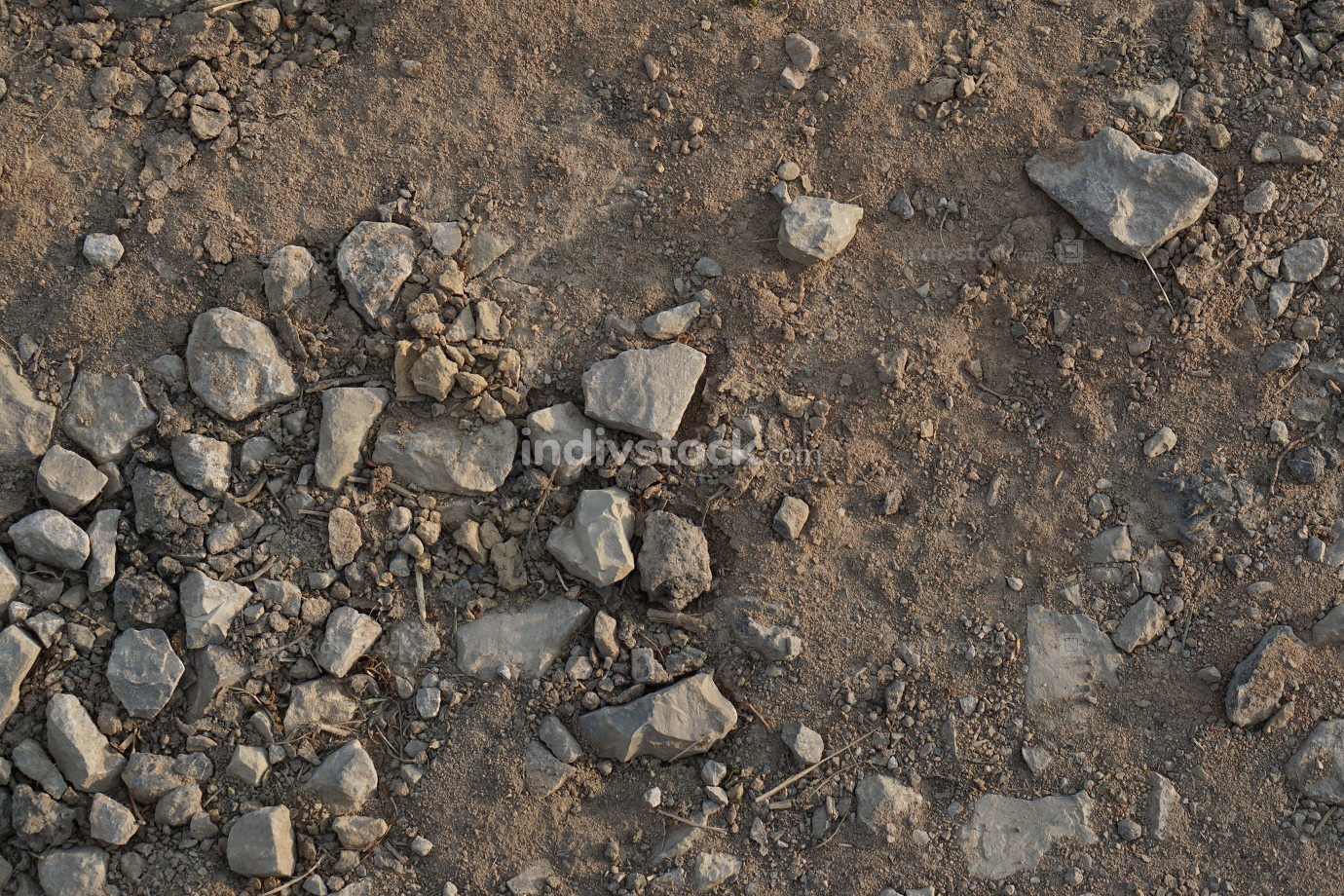 dry road with dirt sand and small stones pebbles
