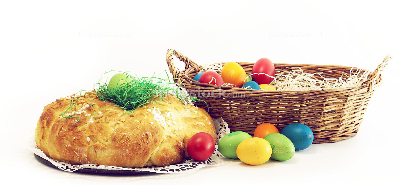 easter eggs easter basket and yeast pastries bread plait