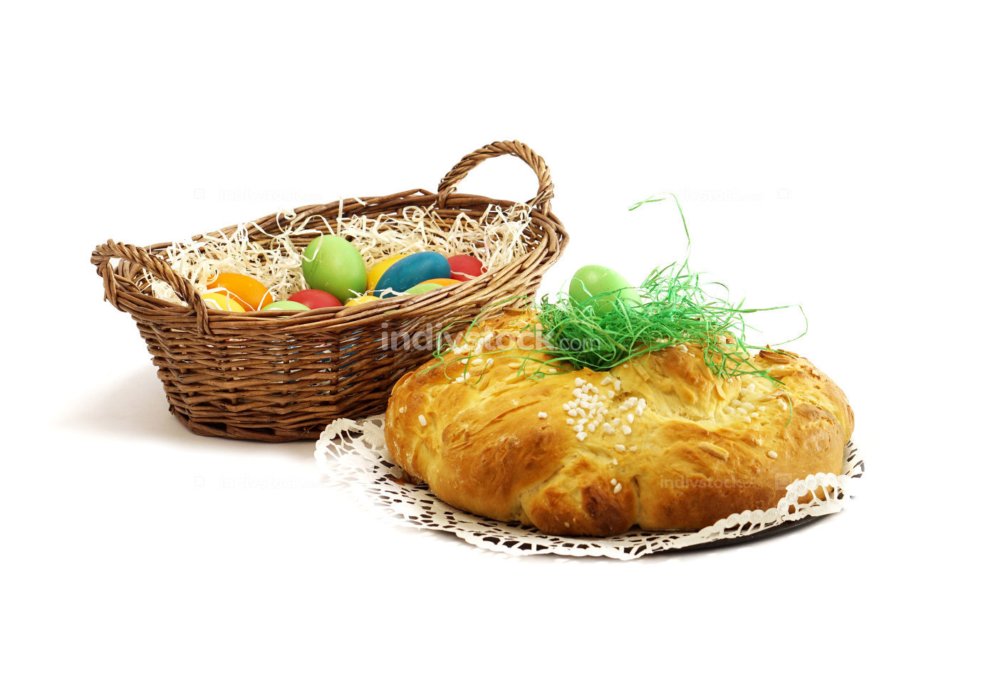 easter eggs in basket with yeast pastries bread plait