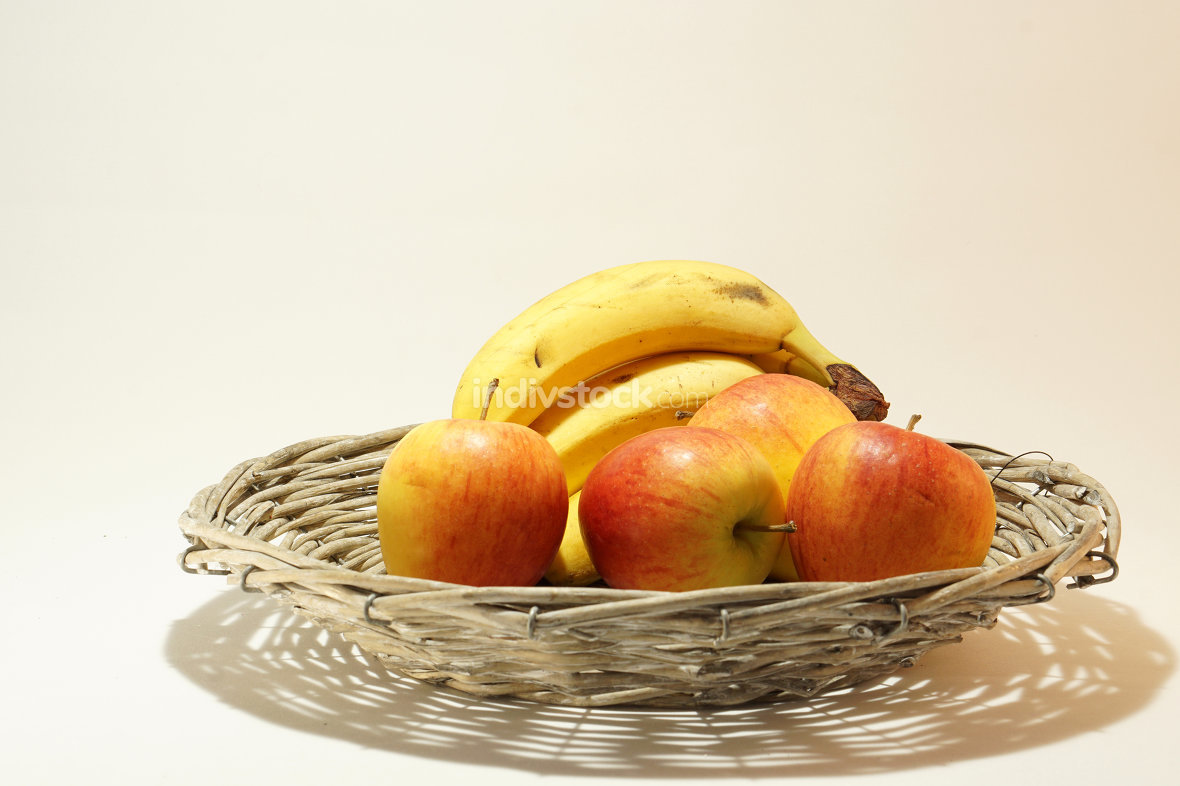fresh ripe bio basket with bananas and apples