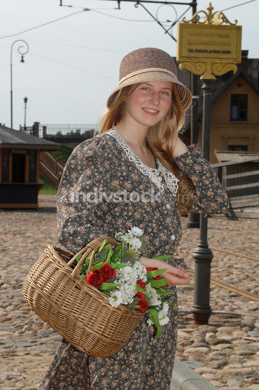 Girl with basket of flowers