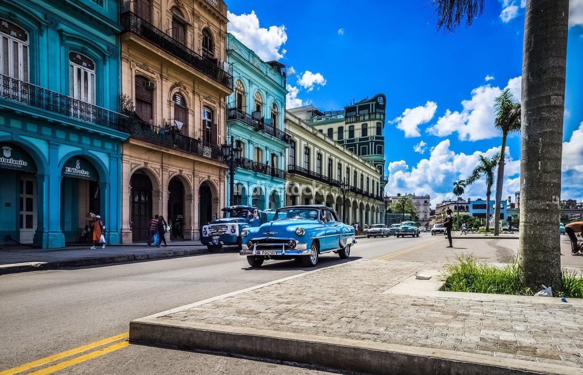 Havana, Cuba - 2016: American blue Chevrolet classic car drives on the main road in Havana Cuba