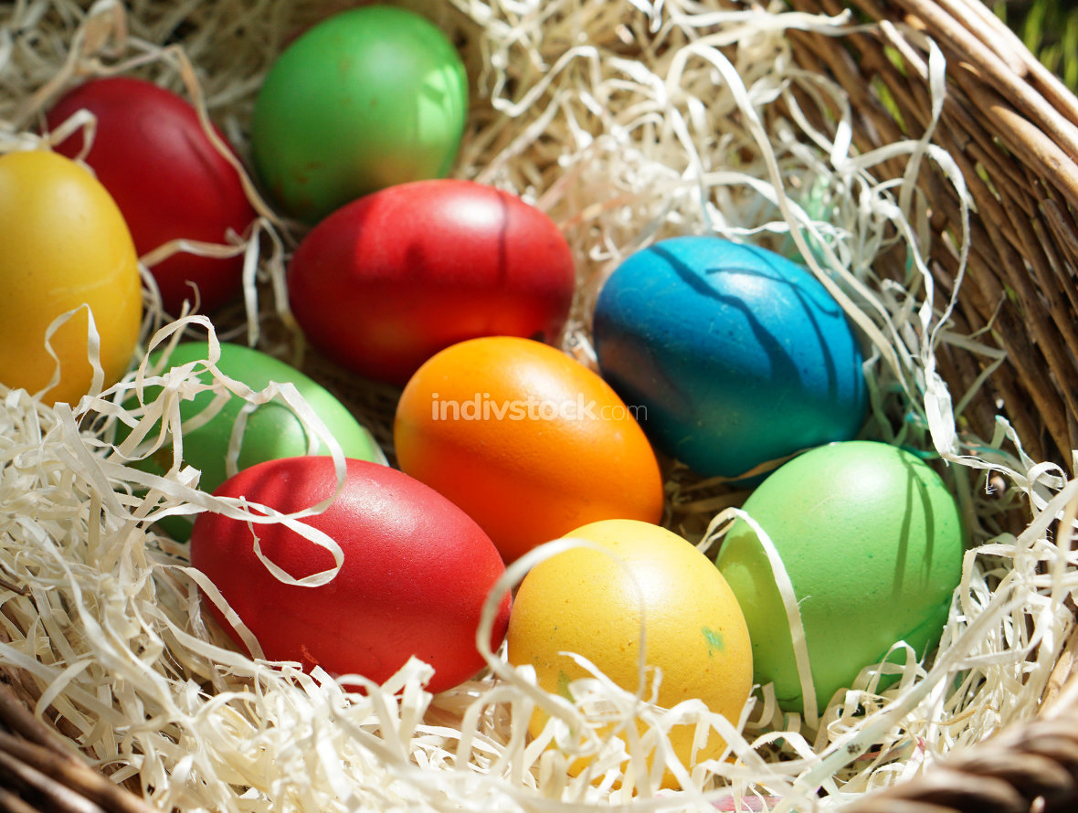 homemade colored easter eggs in easter basket