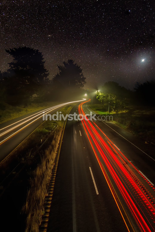 Night Image of Cars on a Highway Under the Stars