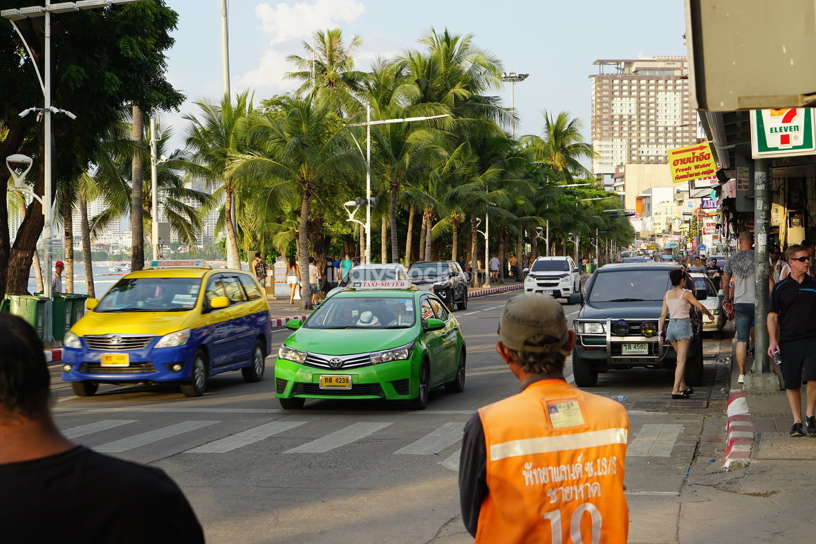 Pattaya beach road in october 2017 with motorbike taxi driver