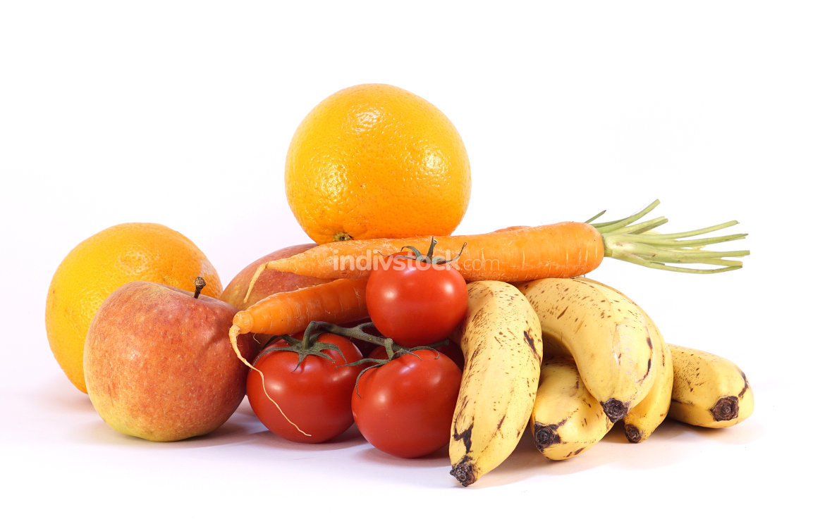 pile of bio fresh ripe oranges tomatoes apples carrots bananas