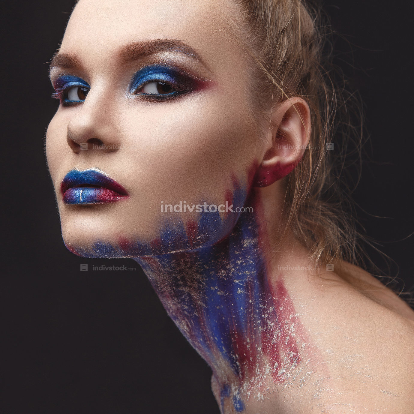 Portrait of beautiful girl with blue tones makeup