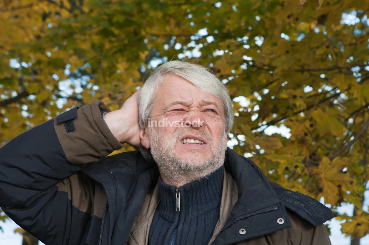 Portrait of middle-aged man in autumn day