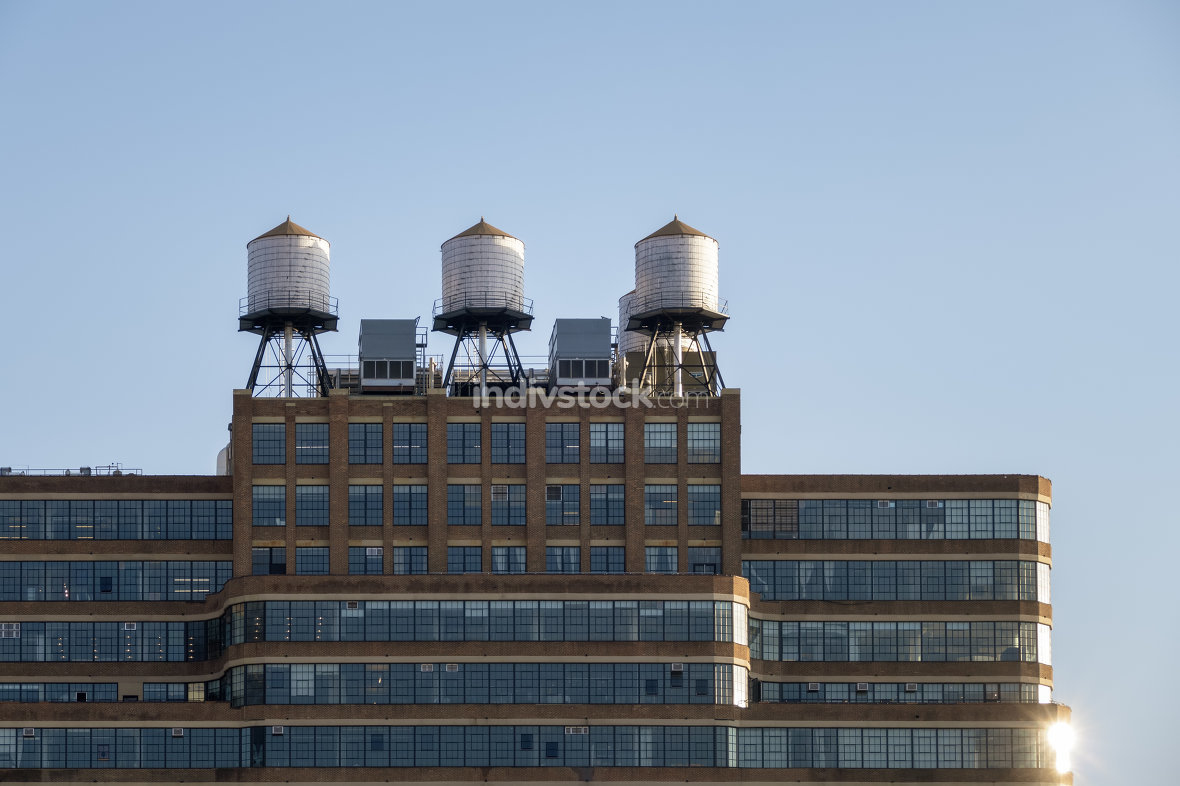 some typical water tanks on the roof of a building in New York C