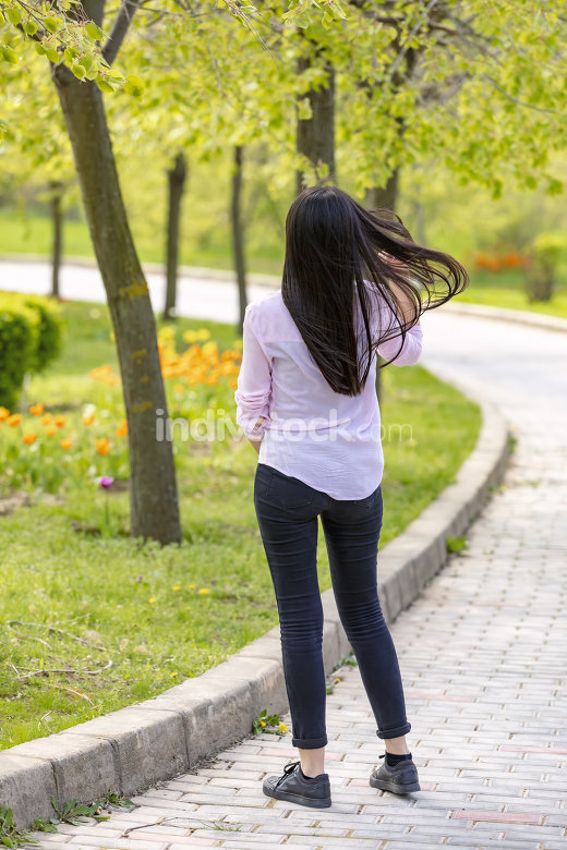Teenager brunette girl walking in park