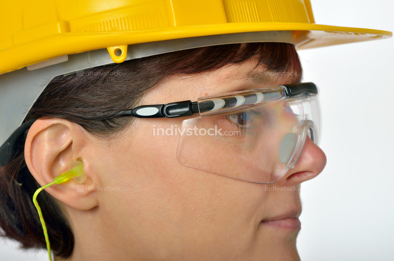 Woman with protective ear plugs