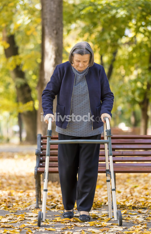 Woman with walker walking outdoors