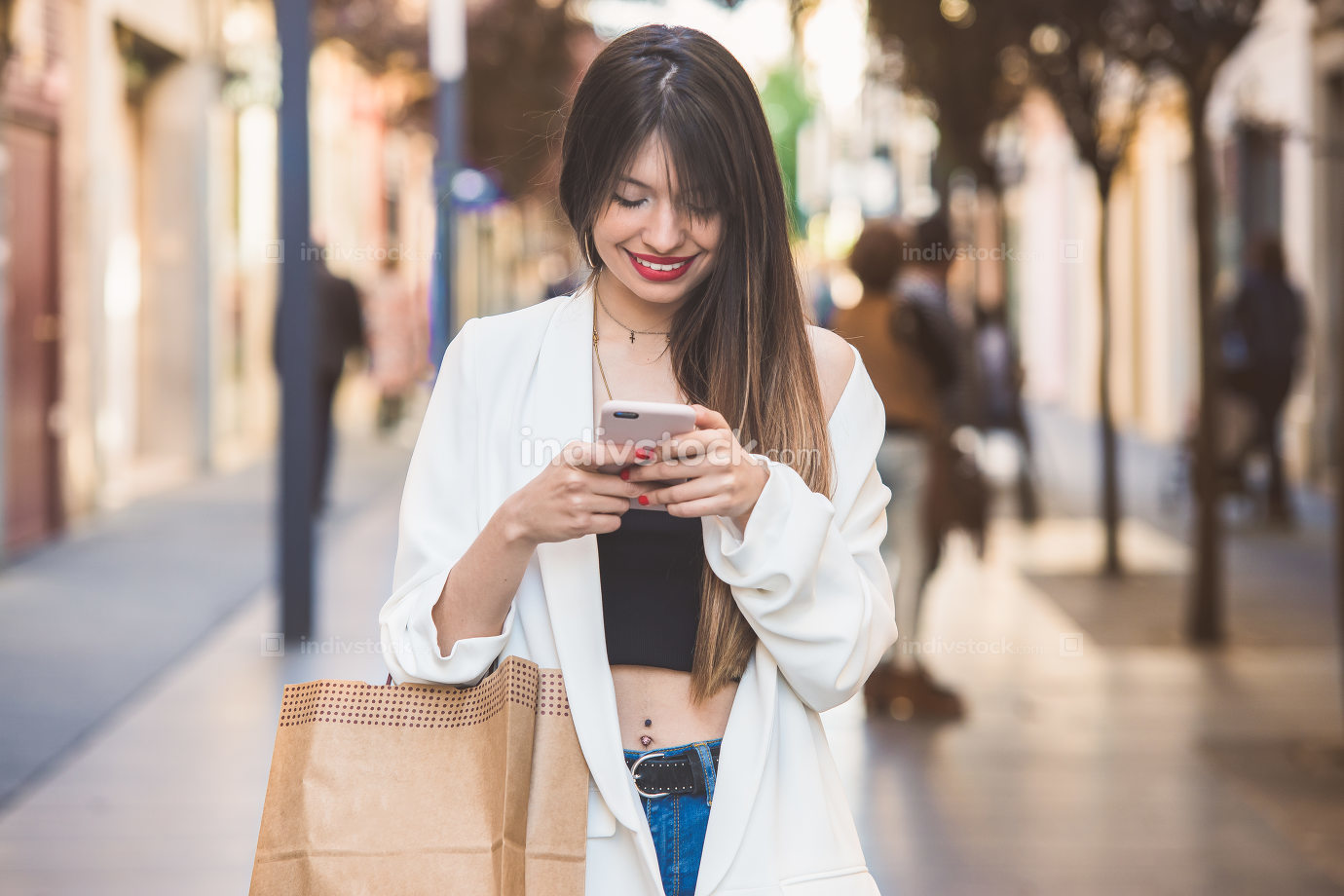 Young beautiful woman buying and chatting with the mobile