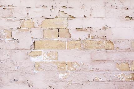 Brick Wall battered and abandoned