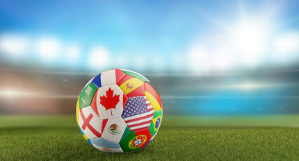 free download: a soccer ball with flags on a soccer field in front of blurred