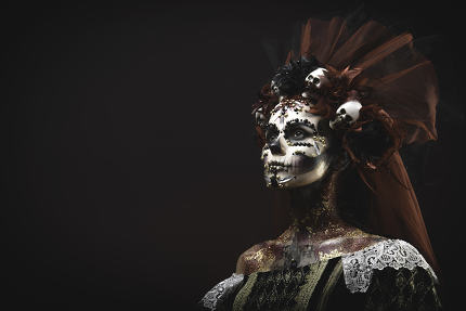 Young girl in the image of Santa Muerte