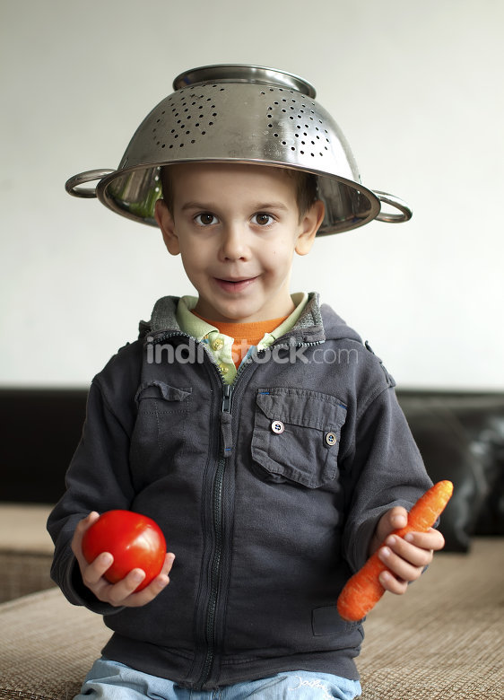Boy with tomato and carrot in hand