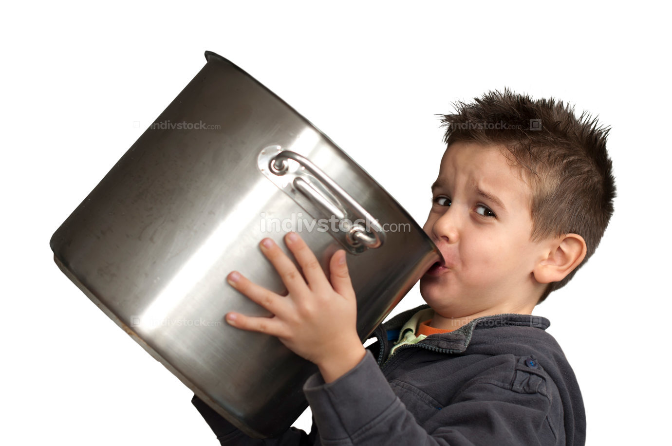 Child drinking milk from a big saucepan