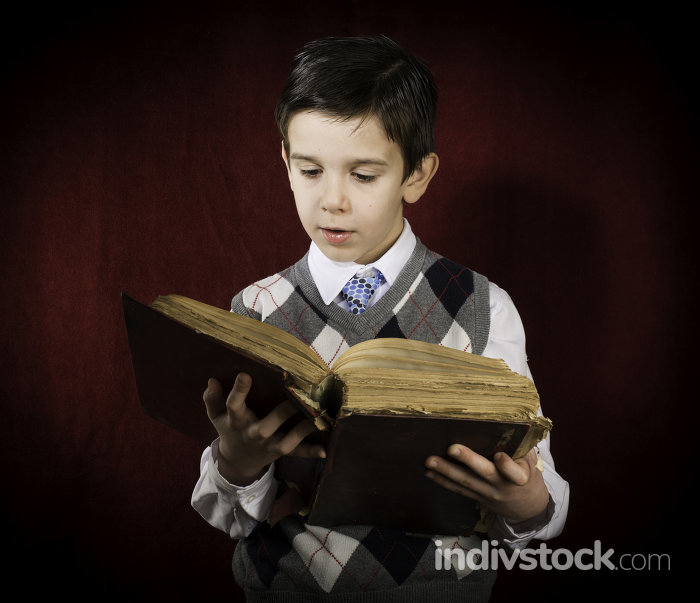 Child with red vintage book