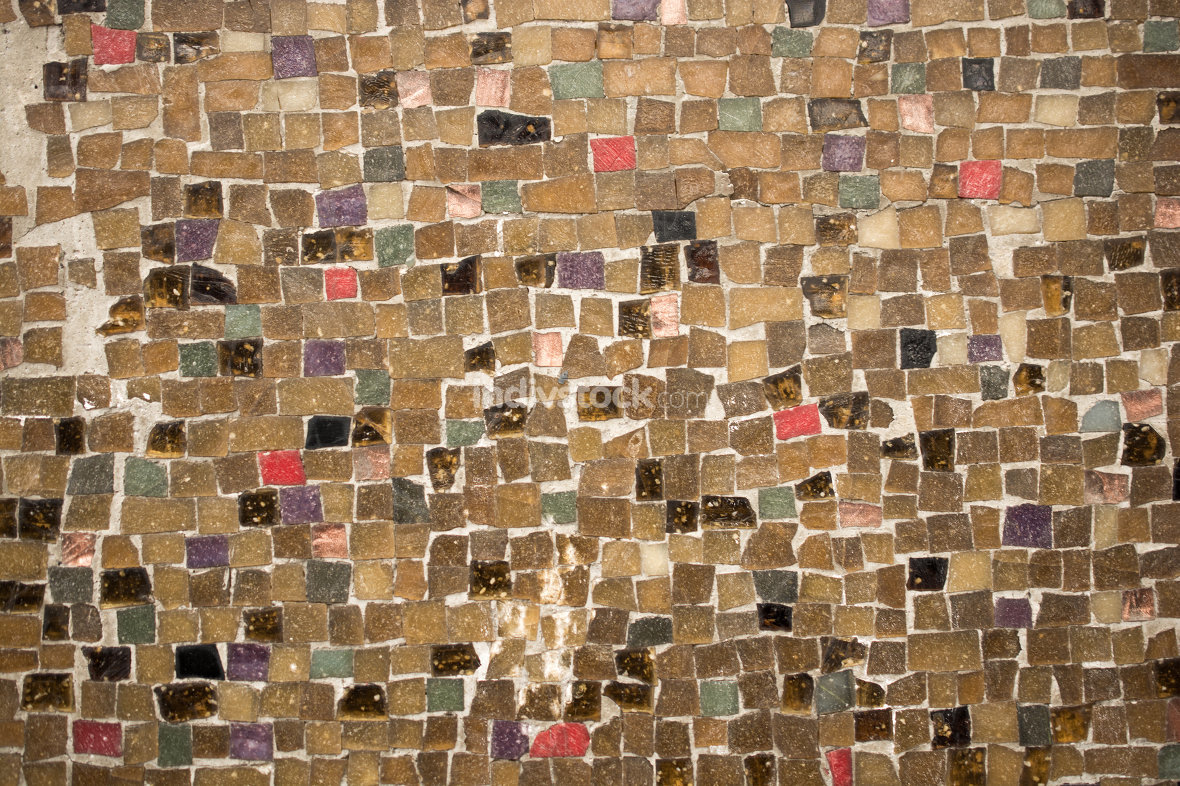 concrete wall covered with colorful mosaic