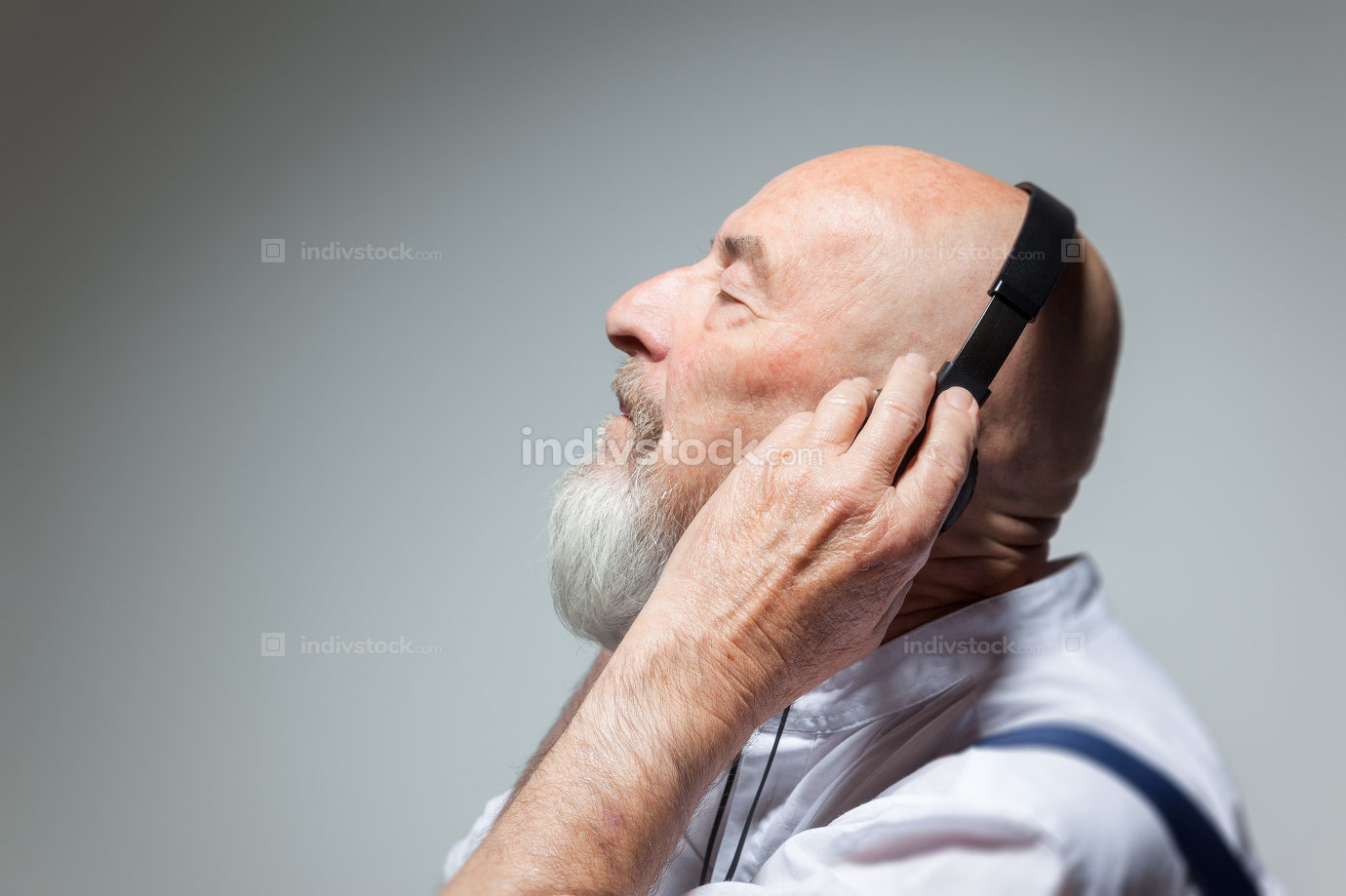 elderly bald head man with headphones